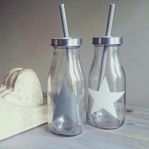 white glass drinking bottle